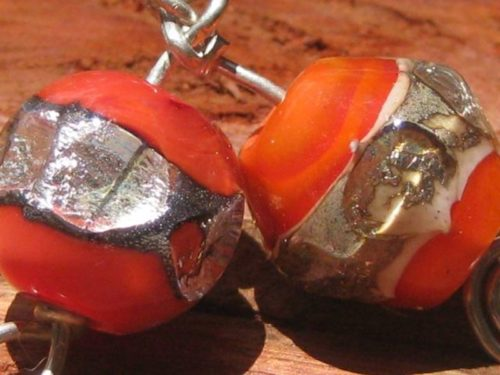 orange glass beads with silver foil inclusions